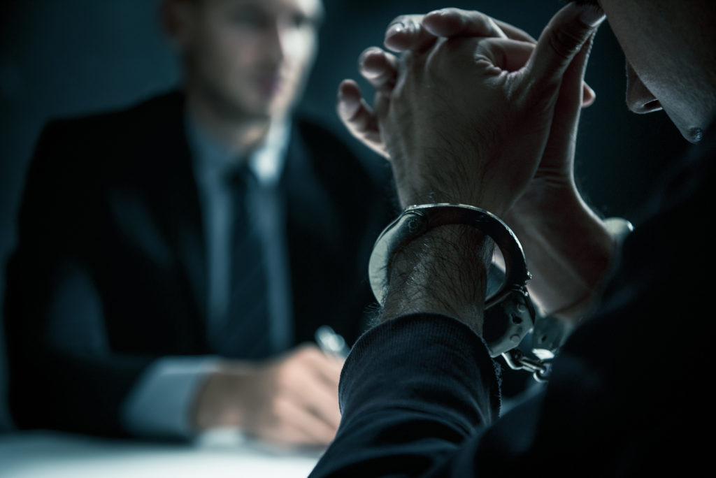 A man sits with his probation officer.